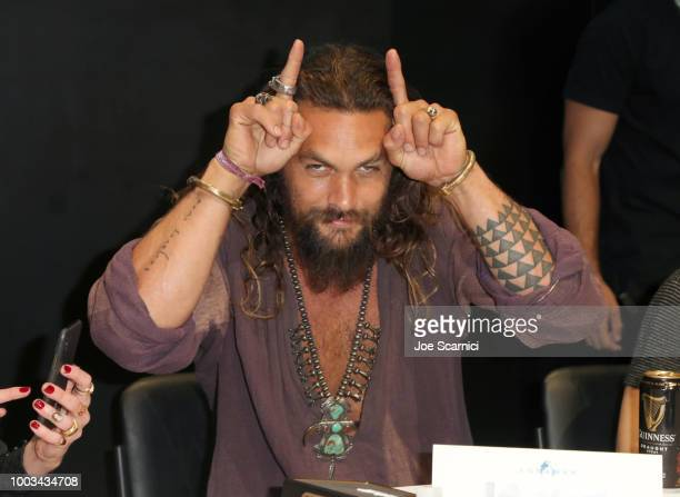 Jason Momoa attends DC Entertainment's Warner Bros Pictures 'Aquaman' Autograph Signing during ComicCon International 2018 at San Diego Convention...