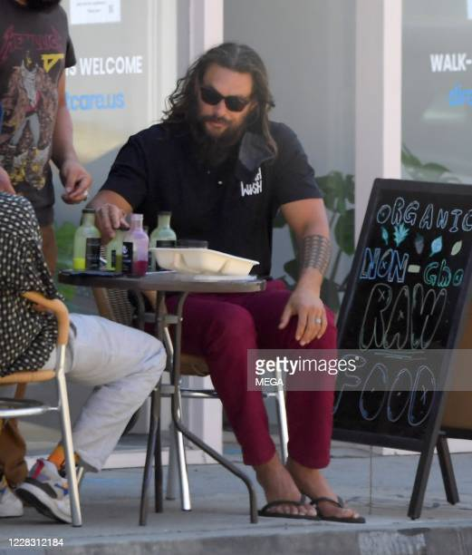 Jason Momoa drinks a organic drink at a juice bar on September 1 2020 in West Hollywood California