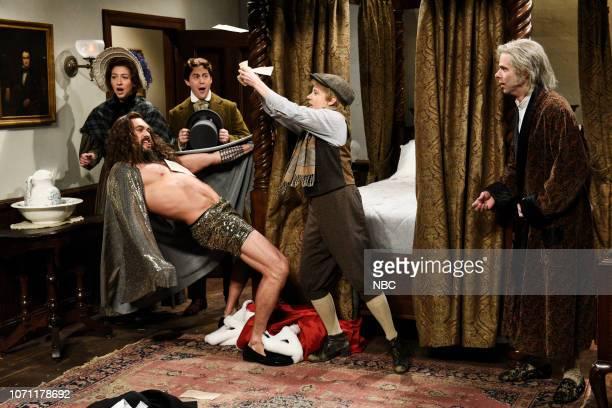 "Jason Momoa"" Episode 1754 -- Pictured: Heidi Gardner as Martha Cratchit, host Jason Momoa as an Extra Christmas Spirit, Alex Moffat as Bob Cratchit,..."