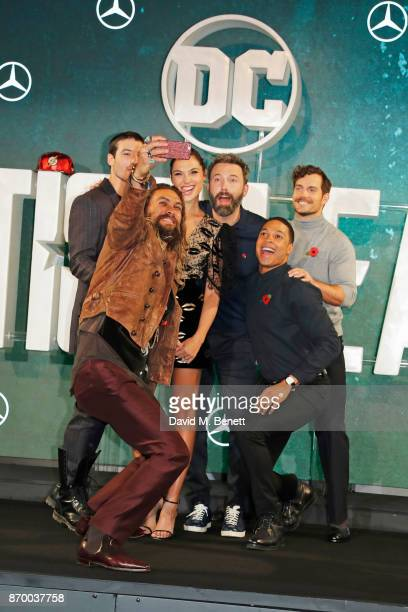 Jason Momoa Ezra Miller Gal Gadot Ben Affleck Ray Fisher and Henry Cavill attend the 'Justice League' photocall at The College on November 4 2017 in...