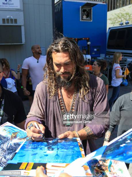 Jason Momoa is seen attending DC Entertainment's Warner Bros Pictures 'Aquaman' Autograph Signing during ComicCon International 2018 at San Diego...
