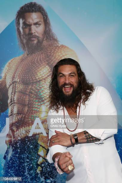 Jason Momoa poses at the Australian premiere of Aquaman on December 18 2018 in Gold Coast Australia