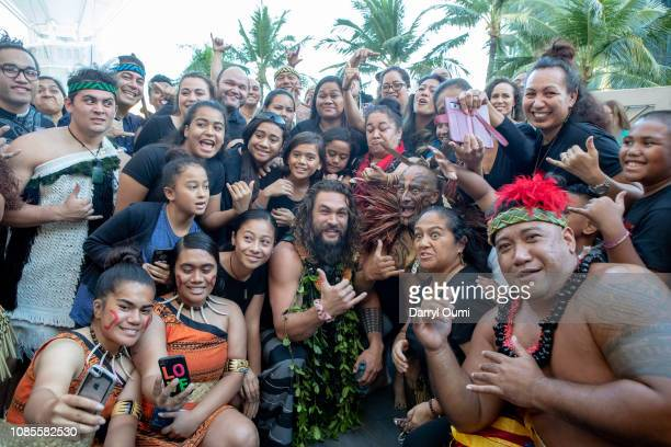 Jason Momoa poses for a photo with fans before the Hawaii screening of Aquaman on December 21 2018 in Honolulu Hawaii