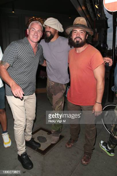 Jason Momoa seen leaving mexican restaurant La Bodega Negra in good spirits after dinner with a group of friends on July 23, 2021 in London, England.