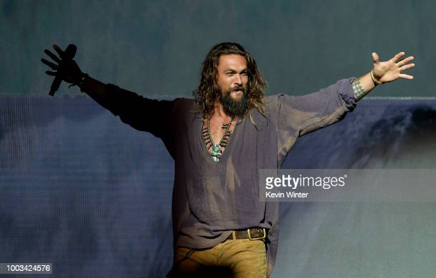 Jason Momoa speaks onstage at the Warner Bros theatrical panel during ComicCon International 2018 at San Diego Convention Center on July 21 2018 in...
