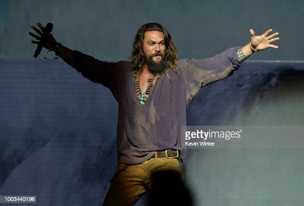 Jason Momoa walks onstage at the Warner Bros 'Aquaman' theatrical panel during ComicCon International 2018 at San Diego Convention Center on July 21...