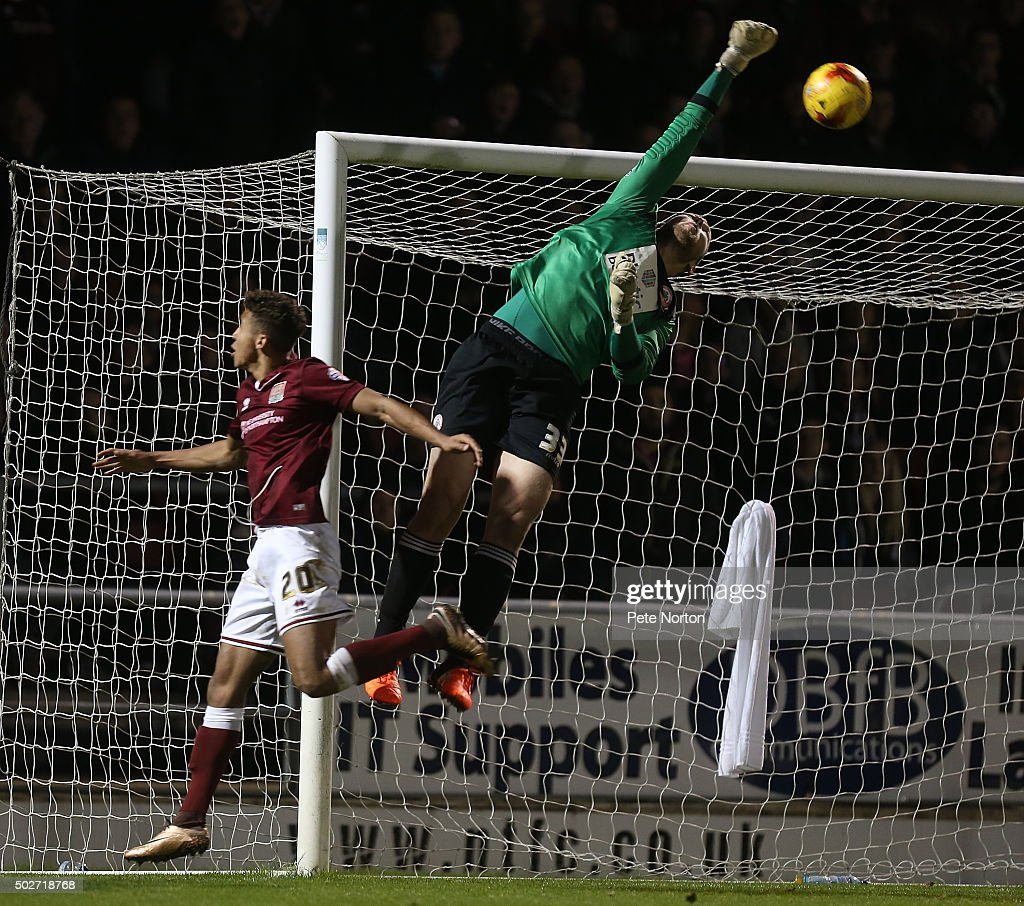 Jason Mooney of Accrington Stanley fails to conect with the ball under pressure from Dominic Calvert-Lewin of Northampton Town during the Sky Bet League Two match between Northampton Town and Accrington Stanley at Sixfields Stadium on December 28, 2015 in Northampton, England.