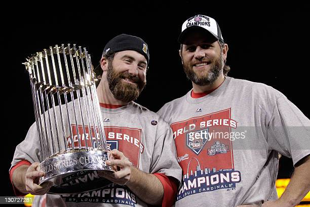 Jason Motte and Lance Berkman of the St Louis Cardinals hold up the World Series trophy after defeating the Texas Rangers 62 in Game Seven of the MLB...