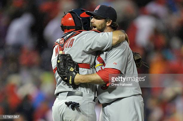 Jason Motte and Yadier Molina of the St Louis Cardinals celebrate after defeating the Philadelphia Phillies 54 in Game Two of the National League...