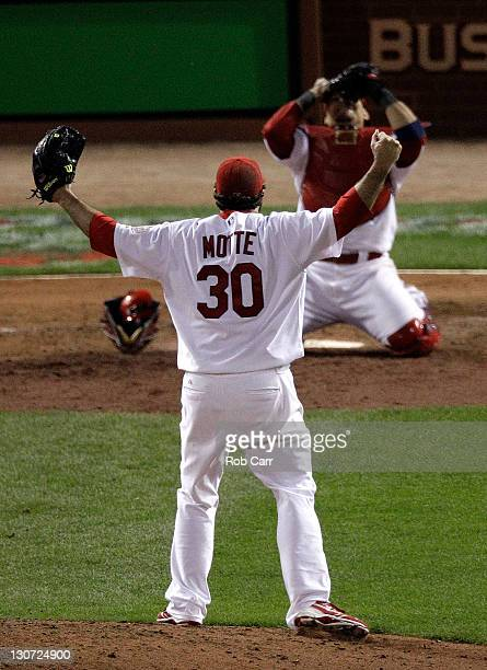 Jason Motte and Yadier Molina of the St Louis Cardinals celebrate after defeating the Texas Rangers 62 to win the World Series during Game Seven of...