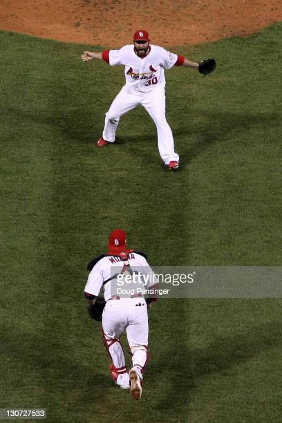 Jason Motte and Yadier Molina of the St Louis Cardinals celebrate after defeating the Texas Rangers 62 to win the World Series in Game Seven of the...