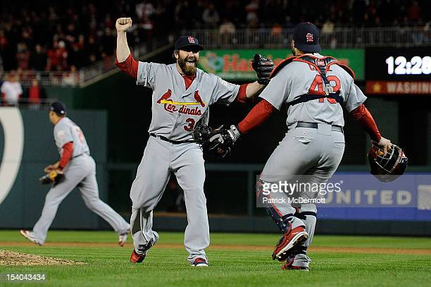Jason Motte celebrates with Tony Cruz of the St Louis Cardinals after the Cardinals defeated the Washington Nationals 97 in Game Five of the National...