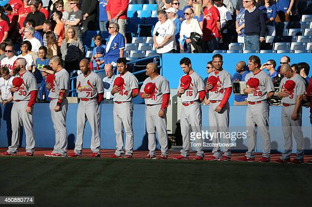 Jason Motte of the St Louis Cardinals and Allen Craig and Sam Freeman and Carlos Martinez and third base coach Jose Oquendo and Randal Grichuk and...