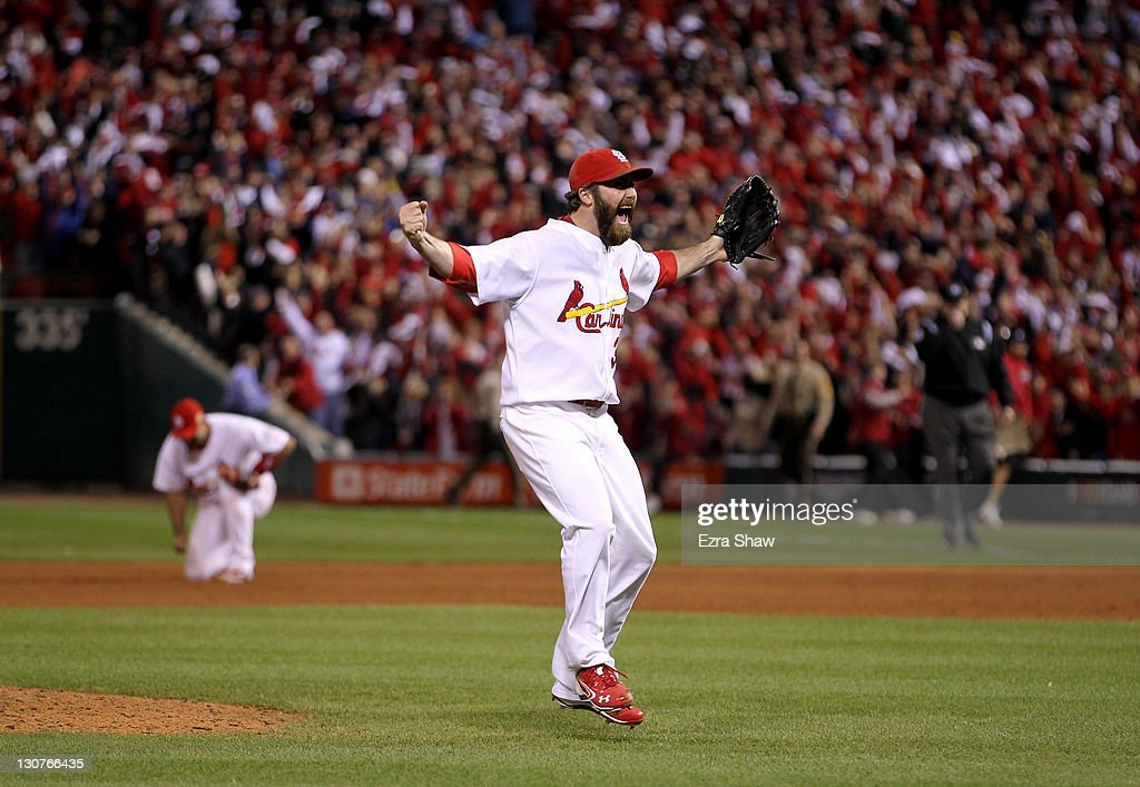 Jason Motte #30 of the St. Louis Cardinals celebrates after defeating the Texas Rangers 6-2 to win the World Series in Game Seven of the MLB World Series at Busch Stadium on October 28, 2011 in St Louis, Missouri.