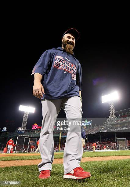Jason Motte of the St Louis Cardinals leaves the field after batting practice before Game Two of the 2013 World Series against the Boston Red Sox at...