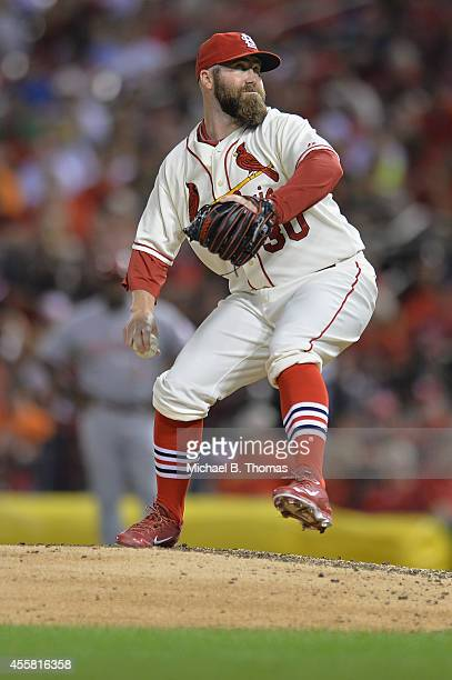 Jason Motte of the St Louis Cardinals relief pitches in the fifth inning against the Cincinnati Reds at Busch Stadium on September 20 2014 in St...