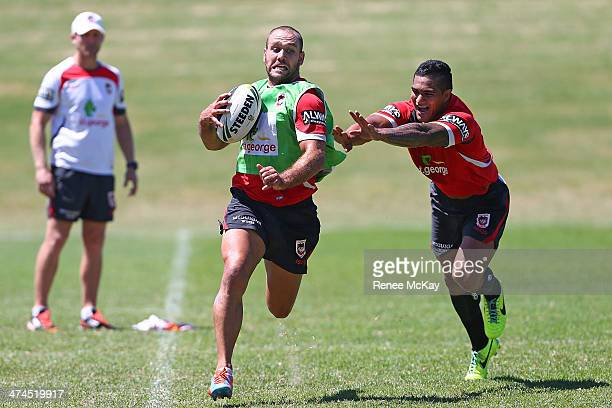 Jason Nightingale gets away from Peter Mata'utia during a St George Dragons NRL media session at WIN Stadium on February 24, 2014 in Wollongong,...