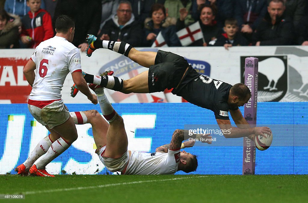 Jason Nightingale of New Zealand goes over for a try during the match between England and New Zealand at the DW Stadium on November 14, 2015 in Wigan, England.