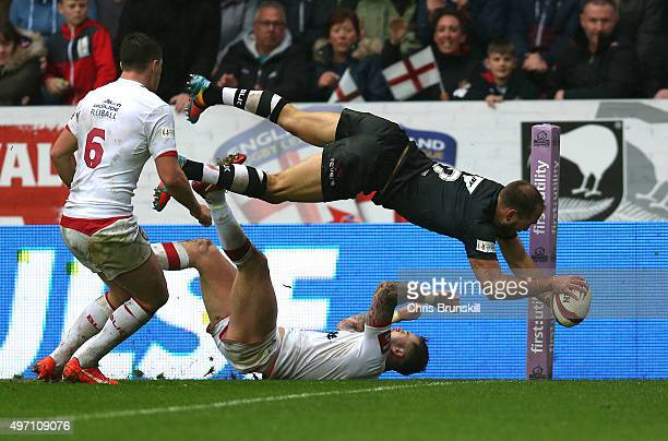 Jason Nightingale of New Zealand goes over for a try during the match between England and New Zealand at the DW Stadium on November 14 2015 in Wigan...