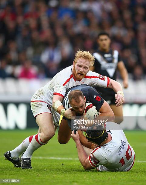 Jason Nightingale of New Zealand is tackled by James Graham and Chris Hill of England during the International Rugby League Test Series match between...