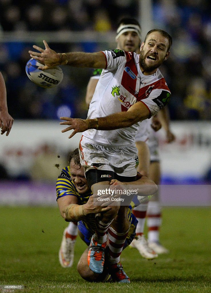 Jason Nightingale of St George Illawarra Dragons is tackled by Ben Westwood of Warrington Wolves during the World Club Series match between Warrington Wolves and St George Illawarra Dragons at The Halliwell Jones Stadium on February 20, 2015 in Warrington, England.