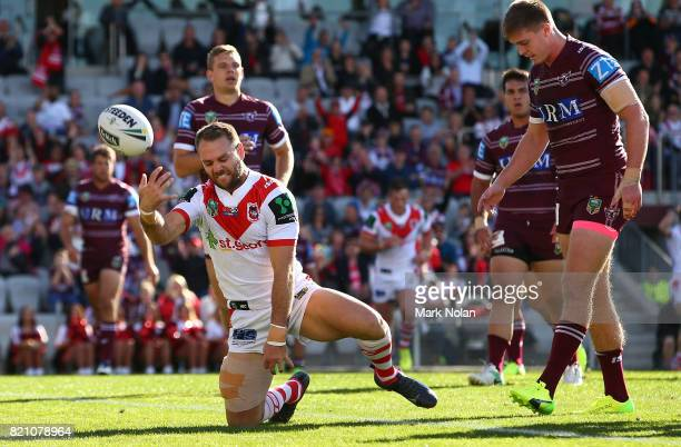 Jason Nightingale of the Dragons celebrates after scoring a try during the round 20 NRL match between the St George Illawarra Dragons and the Manly...
