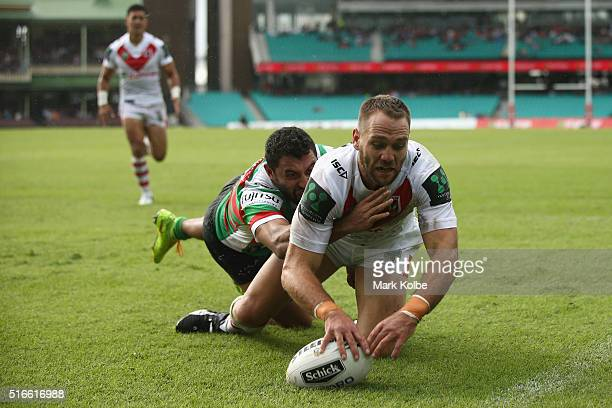 Jason Nightingale of the Dragons dives over to score a try during the round three NRL match between the St George Dragons and the South Sydney...