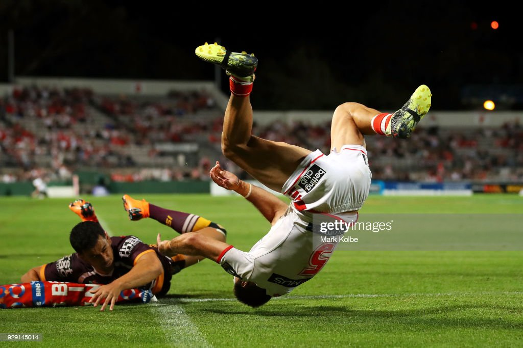 Jason Nightingale of the Dragons flips over as he scores a try during the round one NRL match between the St George Illawarra Dragons and the Brisbane Broncos at UOW Jubilee Oval on March 8, 2018 in Sydney, Australia.