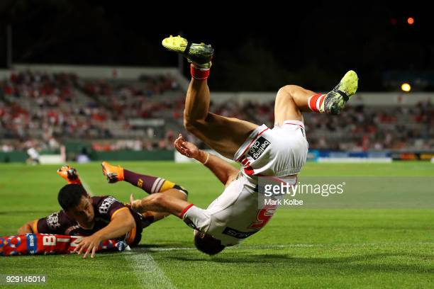 Jason Nightingale of the Dragons flips over as he scores a try during the round one NRL match between the St George Illawarra Dragons and the...