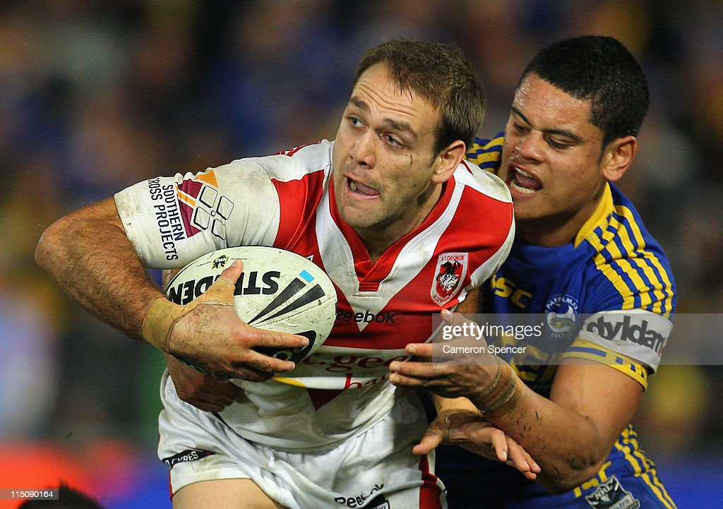 Jason Nightingale of the Dragons is tackled during the round 13 NRL match between the Parramatta Eels and the St George Illawarra Dragons at Parramatta Stadium on June 3, 2011 in Sydney, Australia.