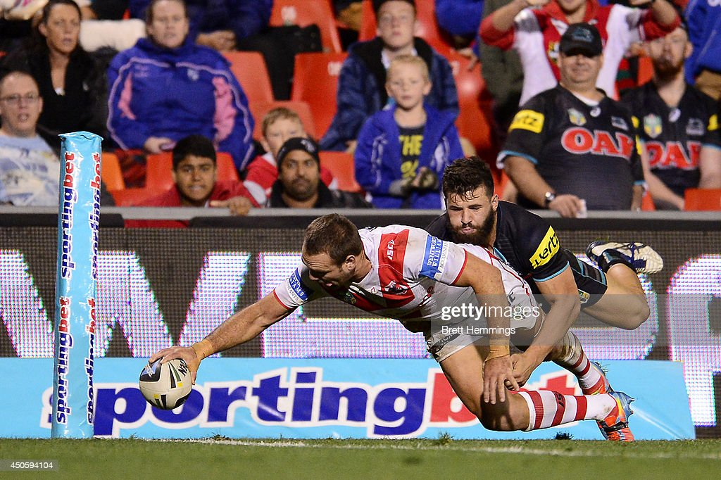 Jason Nightingale of the Dragons reaches for the try line to score during the round 14 NRL match between the Penrith Panthers and the St George Illawarra Dragons at Sportingbet Stadium on June 14, 2014 in Sydney, Australia.