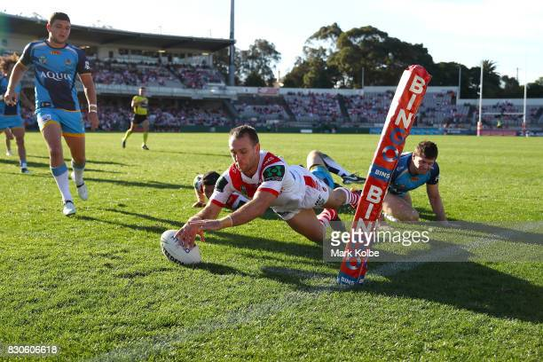 Jason Nightingale of the Dragons scores a try during the round 23 NRL match between the St George Illawarra Dragons and the Gold Coast Titans at UOW...