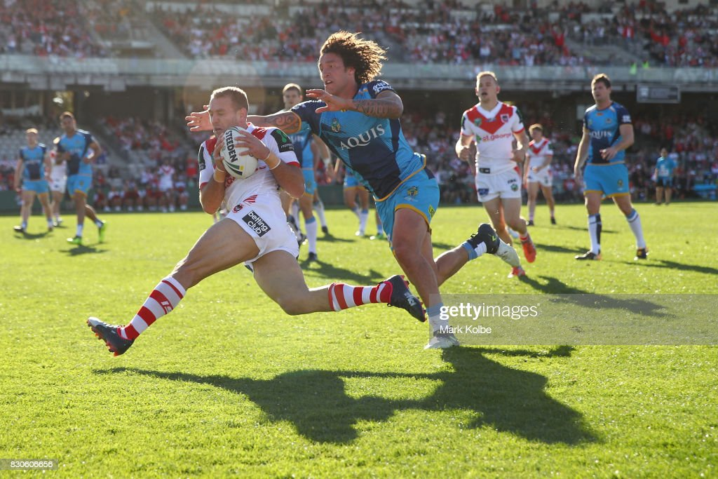 Jason Nightingale of the Dragons scores a try under pressure from Kevin Proctor of the Titans during the round 23 NRL match between the St George Illawarra Dragons and the Gold Coast Titans at UOW Jubilee Oval on August 12, 2017 in Sydney, Australia.
