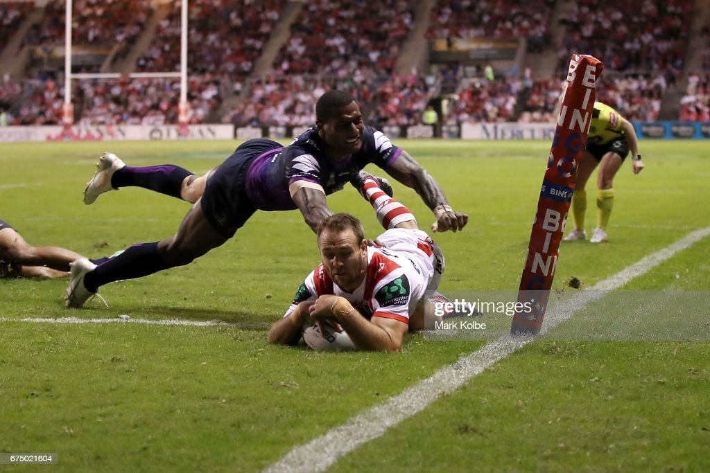 Jason Nightingale of the Dragons scores a try under the diving Suliasi Vunivalu of the Storm during the round nine NRL match between the St George Illawarra Dragons and the Melbourne Storm at WIN Stadium on April 30, 2017 in Wollongong, Australia.