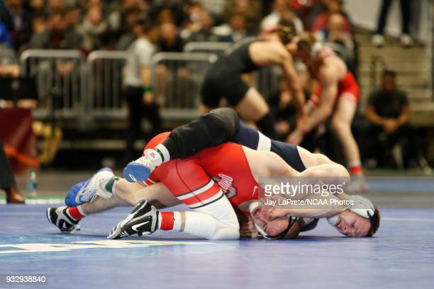 Jason Nolf of Penn State wrestles Micah Jordan of Ohio State in the 157 weight class during the Division I Men's Wrestling Championship held at...