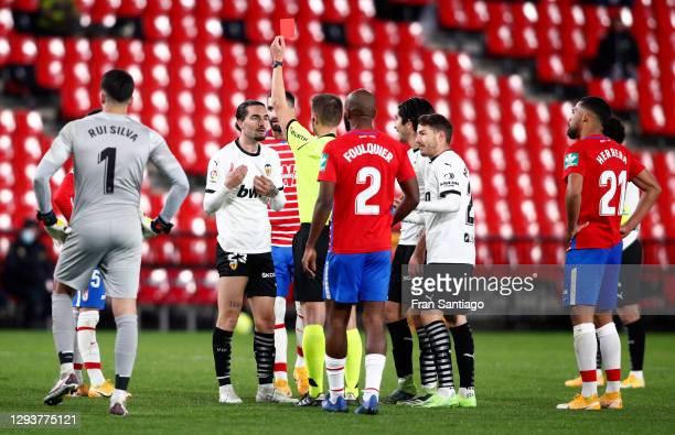 Jason of Valencia CF is shown a red card by Referee Adrian Cordero Vega during the La Liga Santander match between Granada CF and Valencia CF at...