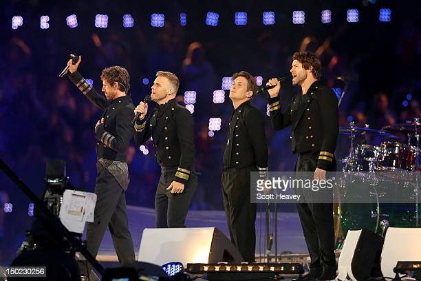 Jason Orange Gary Barlow Mark Owen and Howard Donald of Take That perform during the Closing Ceremony on Day 16 of the London 2012 Olympic Games at...