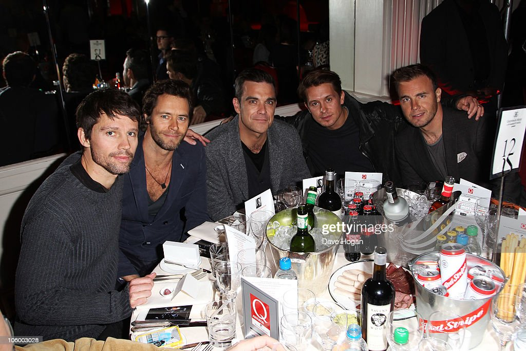 L-R Jason Orange, Howard Donald, Robbie Williams, Mark Owen and Gary Barlow of Take That arrive at the Q Awards 2010 held at The Grosvenor House Hotel on October 25, 2010 in London, England.