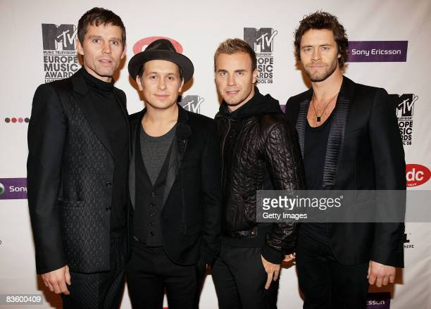 Jason Orange Mark Owen Gary Barlow and Howard Donald arrive for the MTV Europe Music Awards held at the Echo Arena on November 6 2008 in Liverpool...