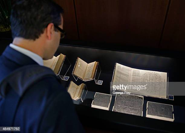 Jason Packham looks at the first 1832 journal from Mormon Church founder Joseph Smith on display at the Church of Jesus Christ of LatterDay Saints...