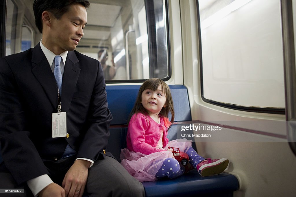 Jason Park, a counsel for the Senate Budget Committee, and his daughter, Avery, 3, ride the Senate subway to the Capitol on Take Your Child To Work Day.