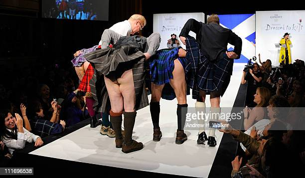 Jason Patric Jim Gaffigan Brian Cox Chris Noth and Kiefer Sutherland lift their kilts on the runway at the 9th Annual 'Dressed To Kilt' charity...