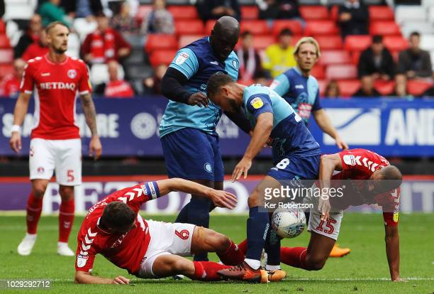 Jason Pearce of Charlton Athletic Adebayo Akinfenwa of Wycombe Wanderers Curtis Thompson of Wycombe Wanderers and Darren Pratley of Charlton Athletic...