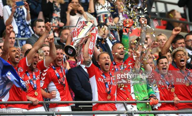 Jason Pearce of Charlton Athletic and Chris Solly of Charlton Athletic lift the trophy following their victory and promotion in the Sky Bet League...