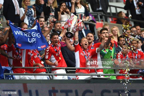 Jason Pearce of Charlton Athletic celebrates with the Sky Bet League One Playoff Final Trophy following his team's victory in the Sky Bet League One...