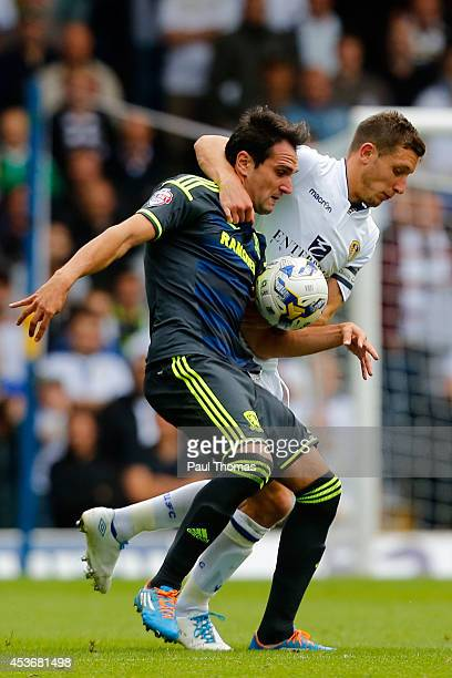 Jason Pearce of Leeds in action with Kike of Middlesbrough during the Sky Bet Championship match between Leeds United and Middlesbrough at Elland...