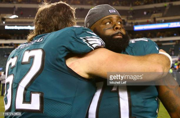 Jason Peters and Jason Kelce of the Philadelphia Eagles embrace on the field after a 17-9 loss to the Seattle Seahawks in the NFC Wild Card Playoff...