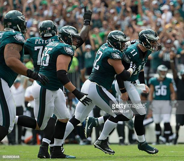Jason Peters Lane Johnson Jason Kelce and Carson Wentz of the Philadelphia Eagles celebrate during the game against the Cleveland Browns at Lincoln...