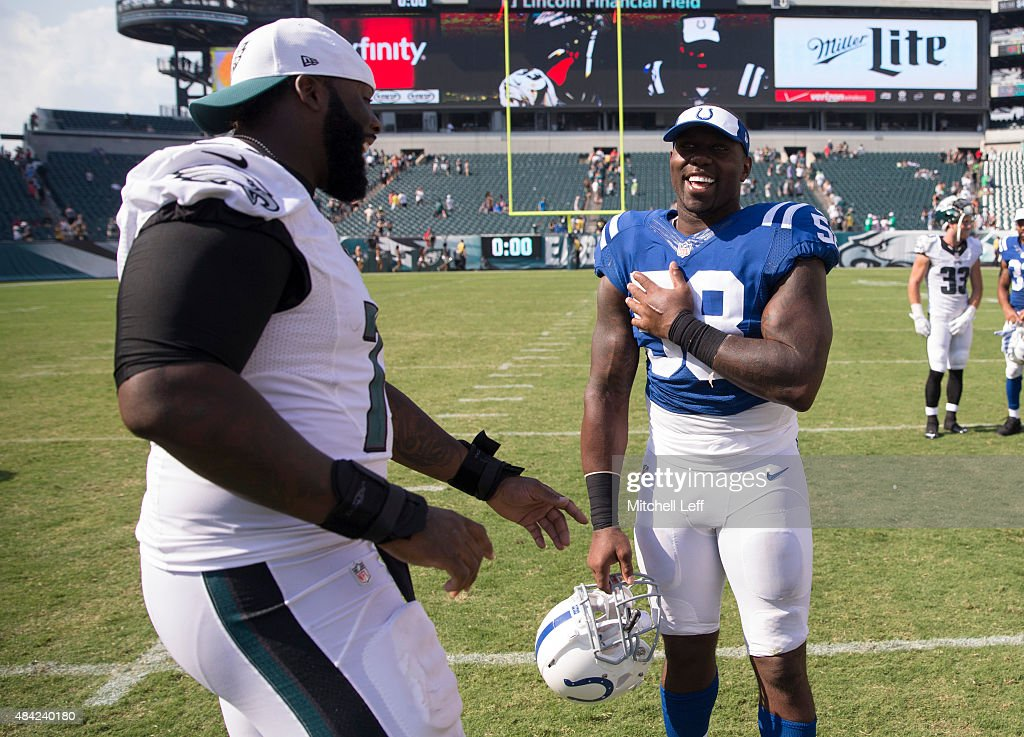 Jason Peters #71 of the Philadelphia Eagles jokes around with Trent Cole #58 of the Indianapolis Colts after the game on August 16, 2015 at Lincoln Financial Field in Philadelphia, Pennsylvania. The Eagles defeated the Colts 36-10.
