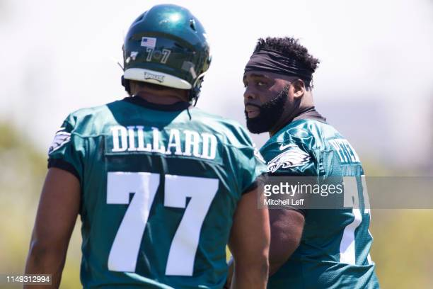 Jason Peters of the Philadelphia Eagles talks to Andre Dillard during mandatory minicamp at the NovaCare Complex on June 11 2019 in Philadelphia...